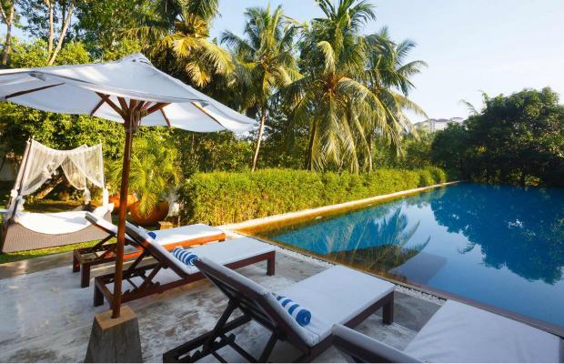 фотографии отеля Tamarind Hill изображение №7